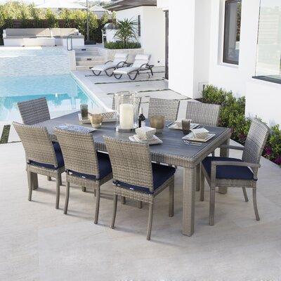 Alfonso 9 Piece Dining Set with Cushion Cushion Color: Navy