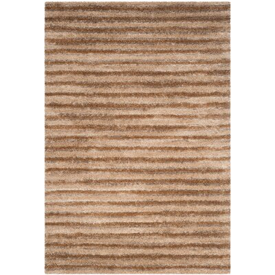 Freda Brown Area Rug Rug Size: 67 x 96