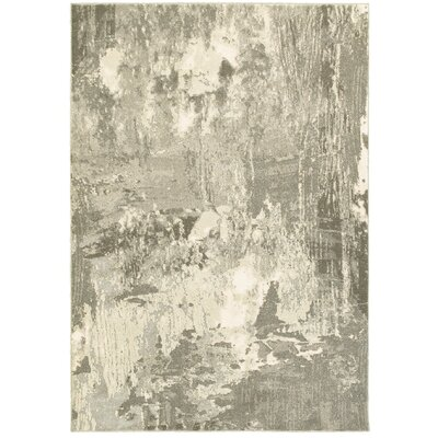 Leonidas Ivory/Gray Area Rug Size: 67 x 96