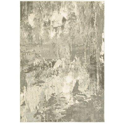 Leonidas Ivory/Gray Area Rug Size: 710 x 1010