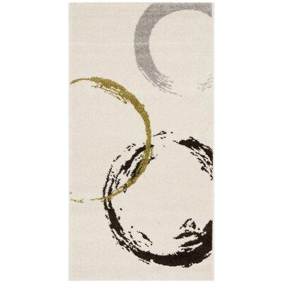 Kenzo Ivory/Green Area Rug Rug Size: 53 x 77