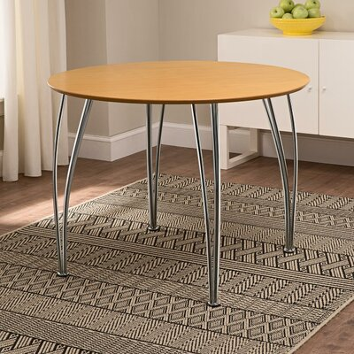 Clovis Round Dining Table Top Finish: Natural