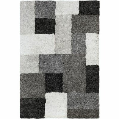 Annie Geometric Hand-Tufted Ivory/Black Area Rug Rug Size: Rectangle 5 x 76