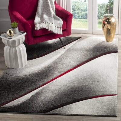 Anne Gray/Red Area Rug Rug Size: 53 x 76