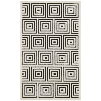 Candor Black/Beige Outdoor Area Rug Rug Size: 33 x 53