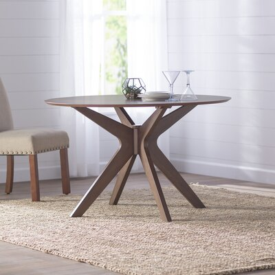 Sheryl Round Dining Table Finish: Walnut