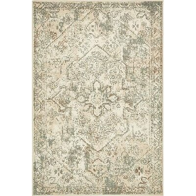 Arika  Cream Area Rug