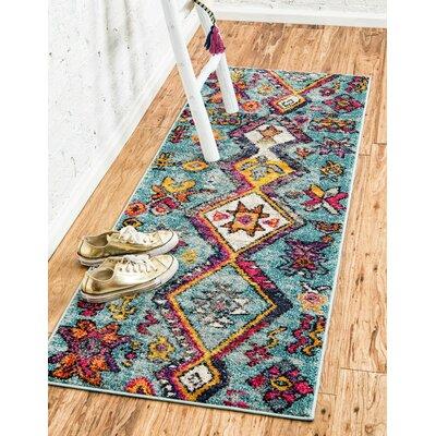Ariyah Turquoise Area Rug Rug Size: 106 x 165