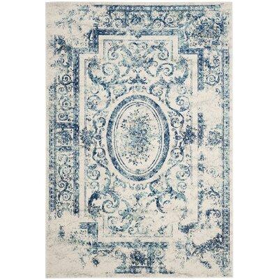 Plaisir Ivory/Blue Area Rug Rug Size: 51 x 76