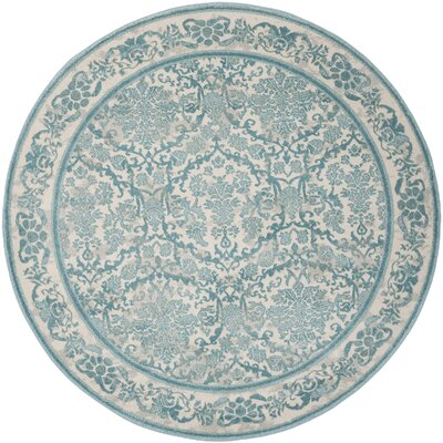 Montelimar Ivory/Light Blue Area Rug Rug Size: Round 67