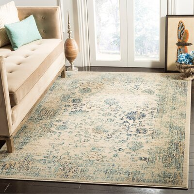 Montelimar Beige/Turquoise Area Rug Rug Size: Rectangle 51 x 76