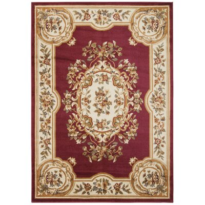 Lukeson Beige/Red Area Rug Rug Size: Rectangle 710 x 106