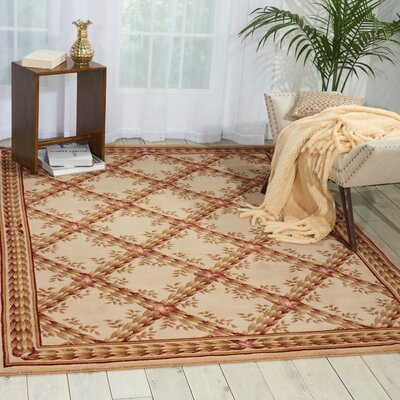 Fairchild Beige Floral and Plants Area Rug Rug Size: 5'6