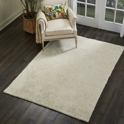 Sinechra Hand Tufted Ivory Area Rug Rug Size: Rectangle 76 x 96