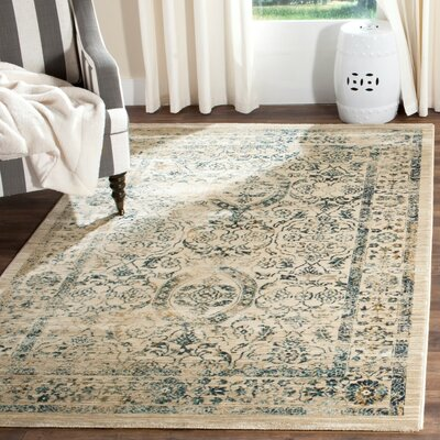 Ruthie Beige/Turquoise Area Rug Rug Size: Rectangle 9 x 12