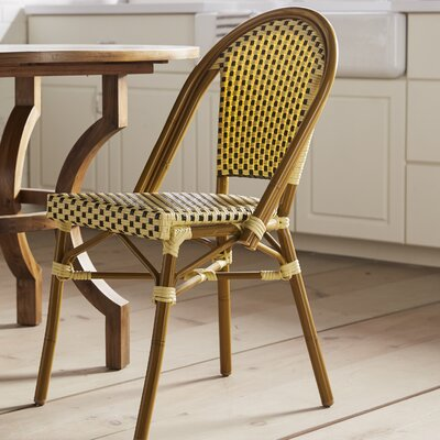 Dolly Stacking Dining Side Chair Finish: Cream / Chocolate