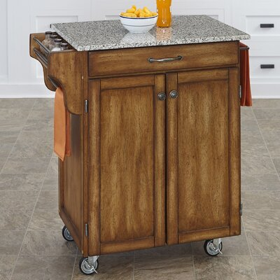 Savorey Kitchen Cart with Granite Top Base Finish: Oak