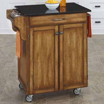Savorey Granite Top Kitchen Cart Base Finish: Oak