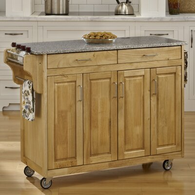Regiene Kitchen Island with Granite Top Base Finish: Natural