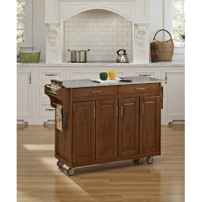 Regiene Kitchen Island with Granite Top Base Finish: Cottage Oak