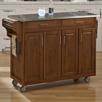 Regiene Kitchen Island with Stainless Steel Top Base Finish: Cottage Oak