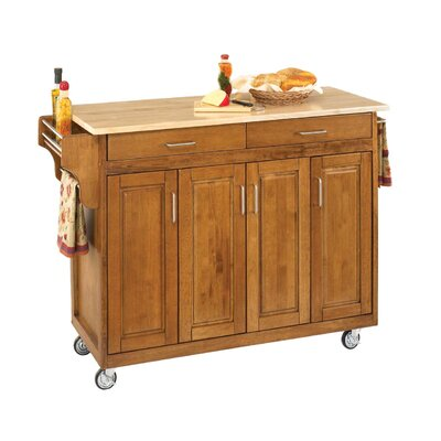 Regiene Kitchen Island with Natural Wood Base Finish: Cottage Oak