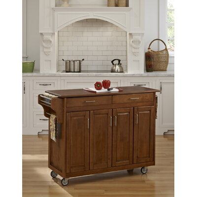 Regiene Kitchen Island Finish: Warm Oak