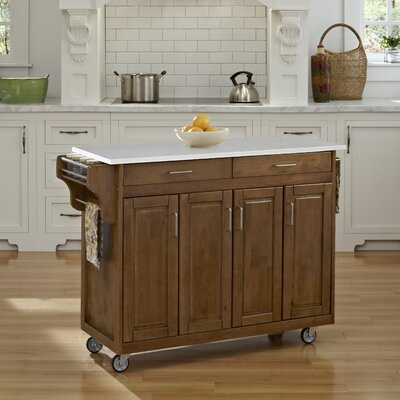 Regiene Kitchen Cart with Quartz Top Base Finish: Oak