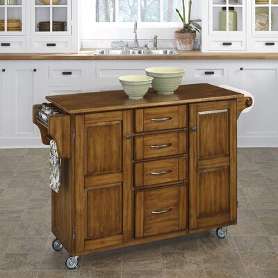 Adelle-a-Cart Kitchen Island Finish: Warm Oak