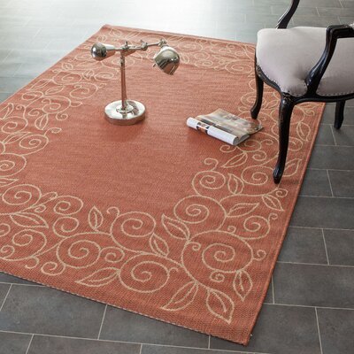 Laurel Rust/Sand Leaves Outdoor Rug Rug Size: 67 x 96