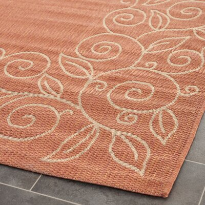 Laurel Rust/Sand Leaves Outdoor Rug Rug Size: 4 x 57
