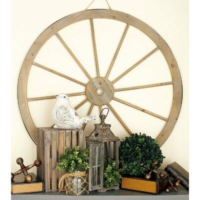 Metal Wagon Wheel Wall Decor Size: 45 H x 45 W x 2 D