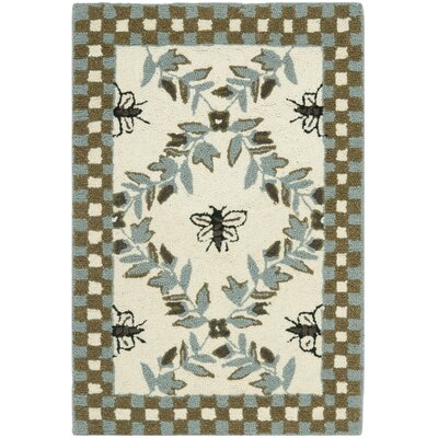 Isabella Ivory/Blue Area Rug Rug Size: Oval 46 x 66