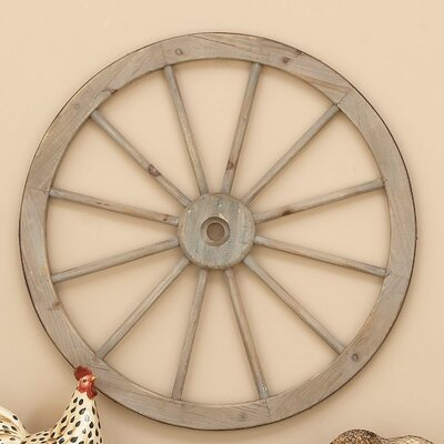 Metal Wagon Wheel Wall Decor Size: 30 H x 30 W x 2 D