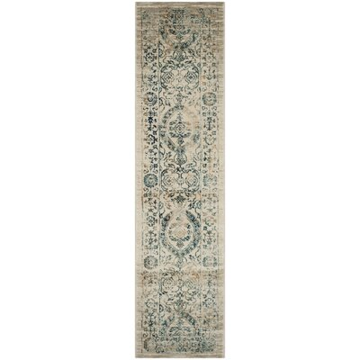 Ruthie Beige/Turquoise Area Rug