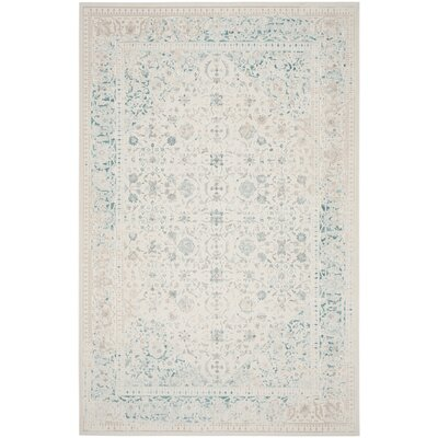 Auguste Turquoise/Ivory Area Rug Rug Size: Rectangle 9 x 12