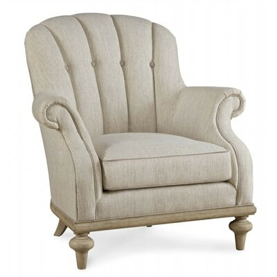 One Upholstered Channel Back Armchair