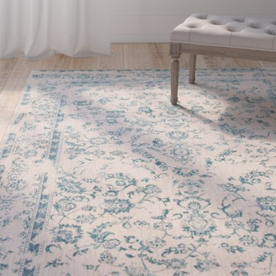 Lyster Ivory/Blue Area Rug Rug Size: 710 x 1010