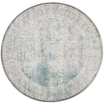 Auguste Turquoise/Ivory Area Rug Rug Size: Round 51