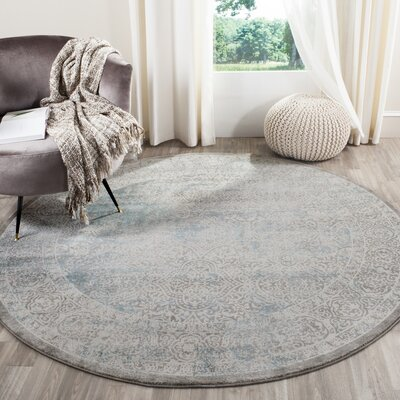 Auguste Turquoise/Ivory Area Rug Rug Size: Round 67