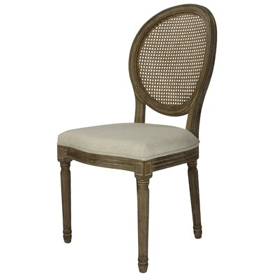 Auclair Weathered Upholstered Dining Chair Upholstery: Cane Beige, Finish: Weathered