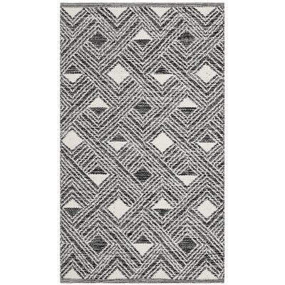 Dominica Hand-Woven Black/Ivory Area Rug Rug Size: Rectangle 8 x 10