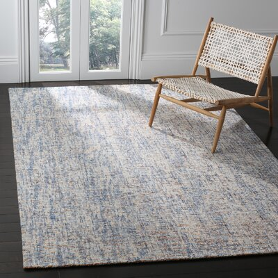 Hand-Tufted Dark Blue/Rust Area Rug Rug Size: 6 x 9