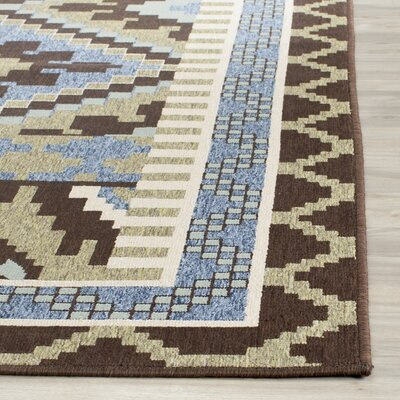 Rangely Green/Chocolate Indoor/Outdoor Area Rug Rug Size: 67 x 96