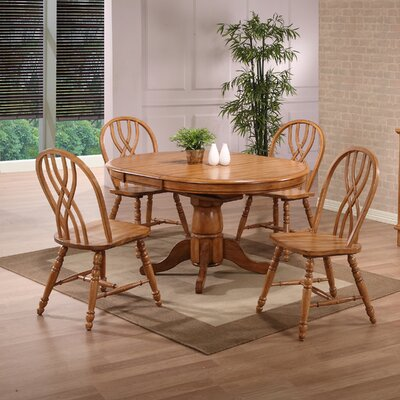 Clarno Extendable Dining Table Table Finish: Solid Oak