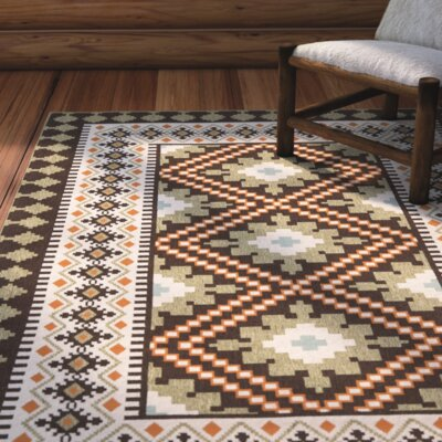 Rangely Chocolate / Terracotta Outdoor Rug Rug Size: 8 x 112