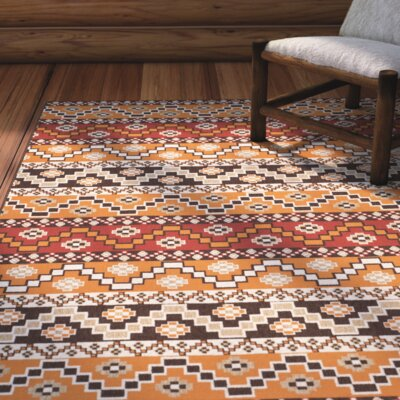 Rangely Red / Chocolate Outdoor Rug Rug Size: 67 x 96
