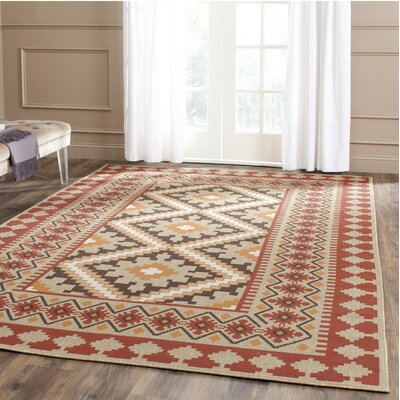Rangely Red & Natural Outdoor/Indoor Area Rug Rug Size: 67 x 96