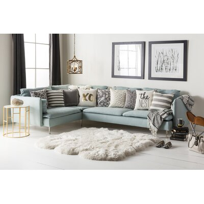 Pierce Faux Sheepskin Ivory Area Rug