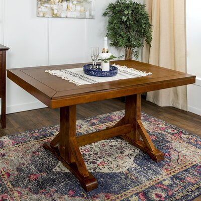 Aubree Wood Dining Table Finish: Antique Brown